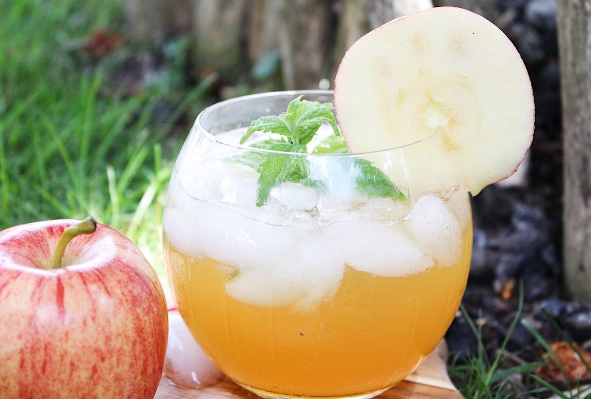 Apple cider mojito in a glass outdoors