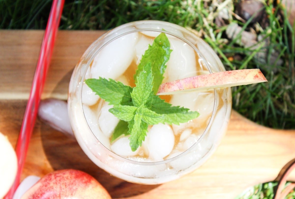 overhead shot of an apple mojito with a sprig of mint.