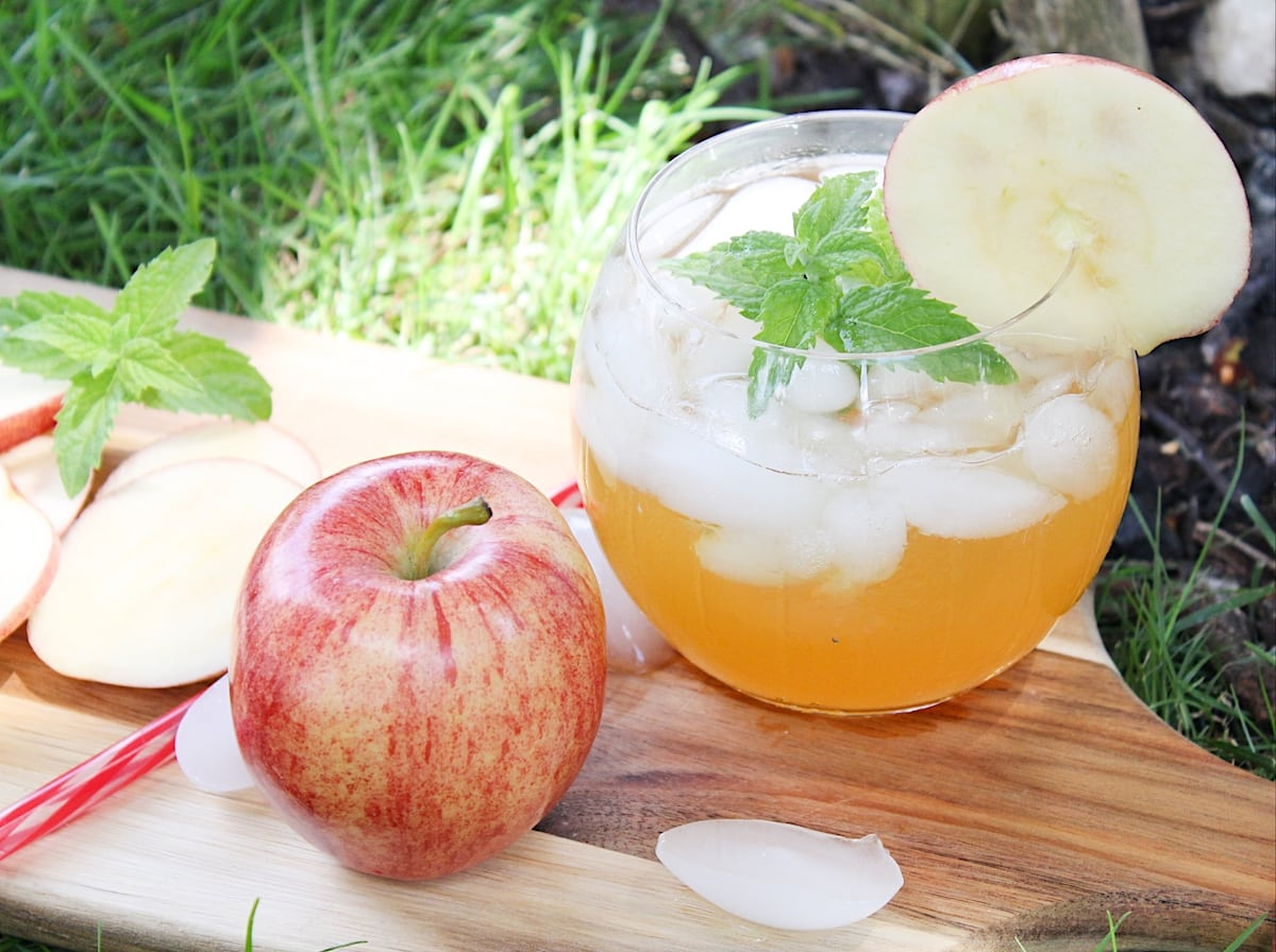 apple cider mojito with an apple on a board