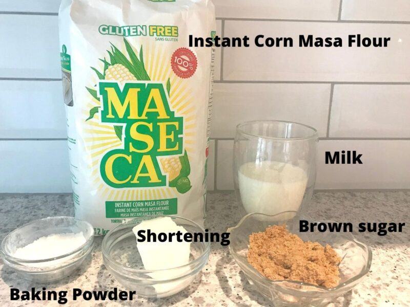 a bag of Maseca on a counter with text overlay of ingredients for plum cobbler