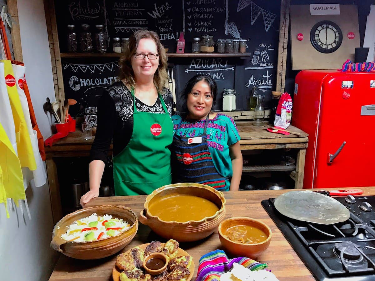 Student and instructor at La Tortilla Cooking School in Antigua Guatemala.