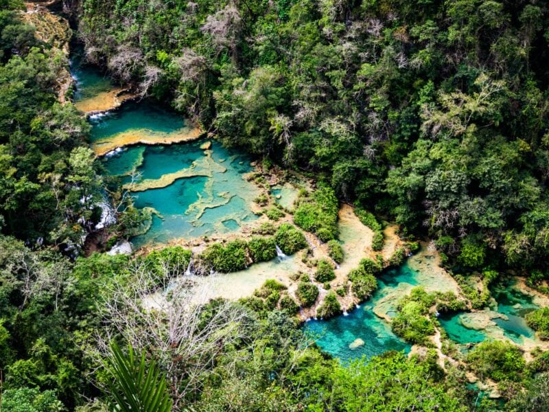 The terraced limestone pools of Semuc Champey are one of the best places to go in Guatemala.
