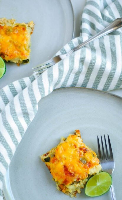 Spanish breakfast casserole with fork on a blue plate.