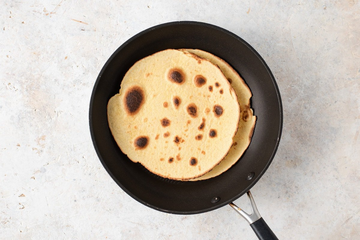 Two tortillas in a skillet.