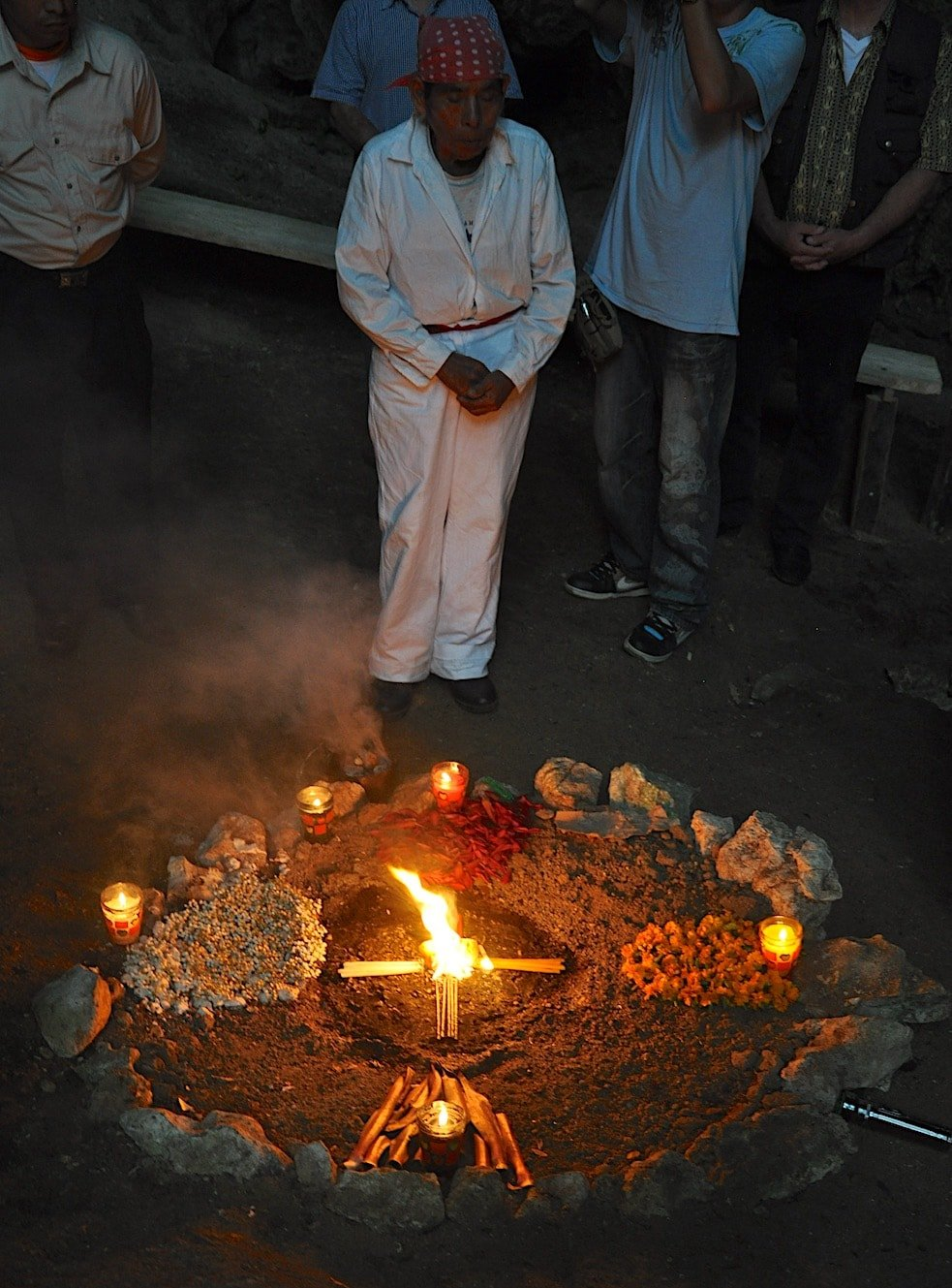 A shaman conducts a Mayan ceremony in a sacred cave near Coban, Guatemala.