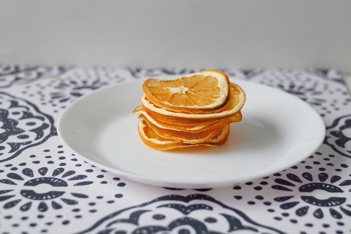 Slices of dehydrated oranges on a plate.