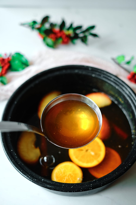 Ladle of spiced holiday tea.