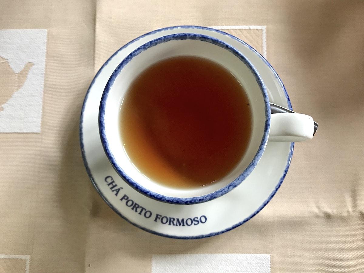 Cup of orange pekoe tea at Porto Formoso tea factory in the Azores.