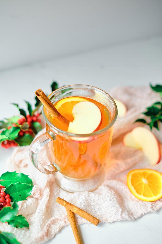 Single mug of Christmas tea with garnish.