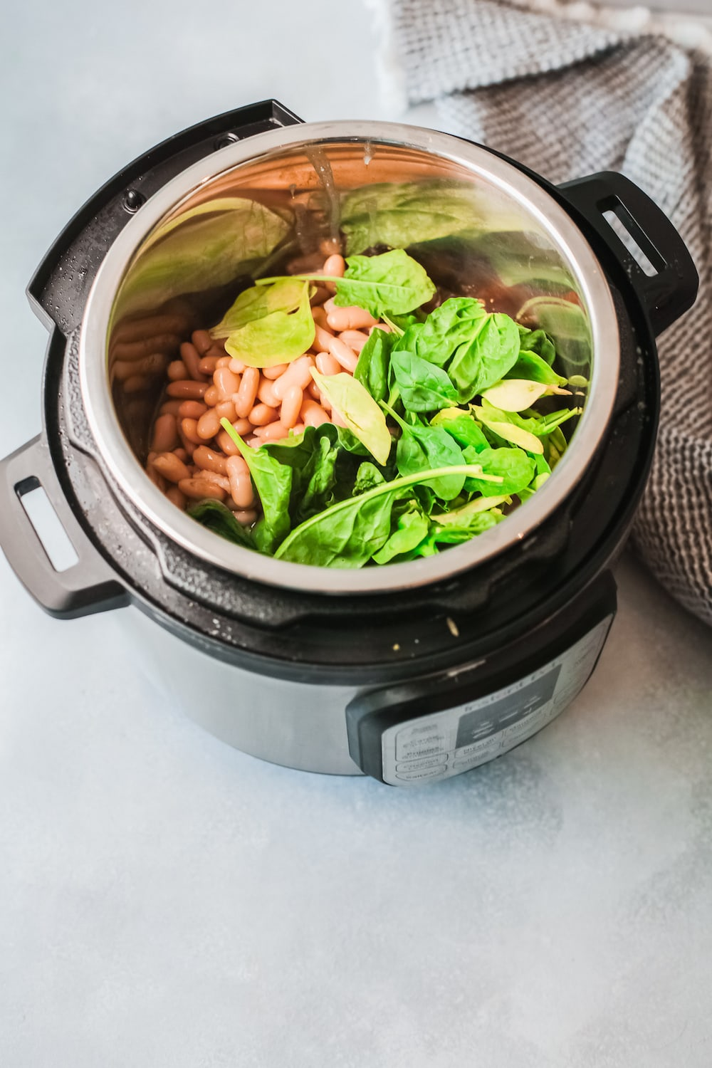Cannellini beans and spinach in an instant pot.