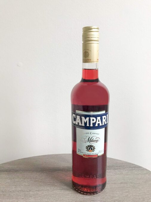 Bottle of Campari on a table.