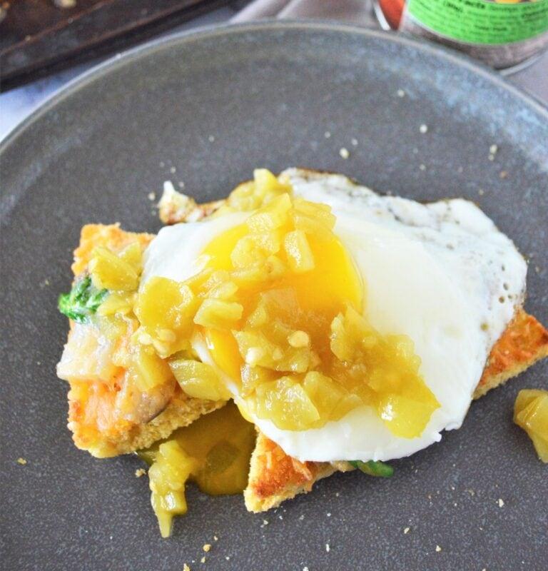Green chile eggs on leftover cornbread.
