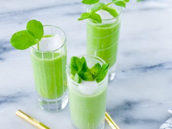 Chilled pea soup in shooter glasses.