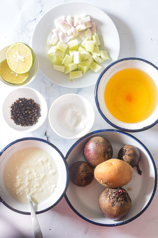 Ingredients fpr beet gazpacho include fresh beets, potato, onion, cucumber, broth and pumpkin seed garnish.