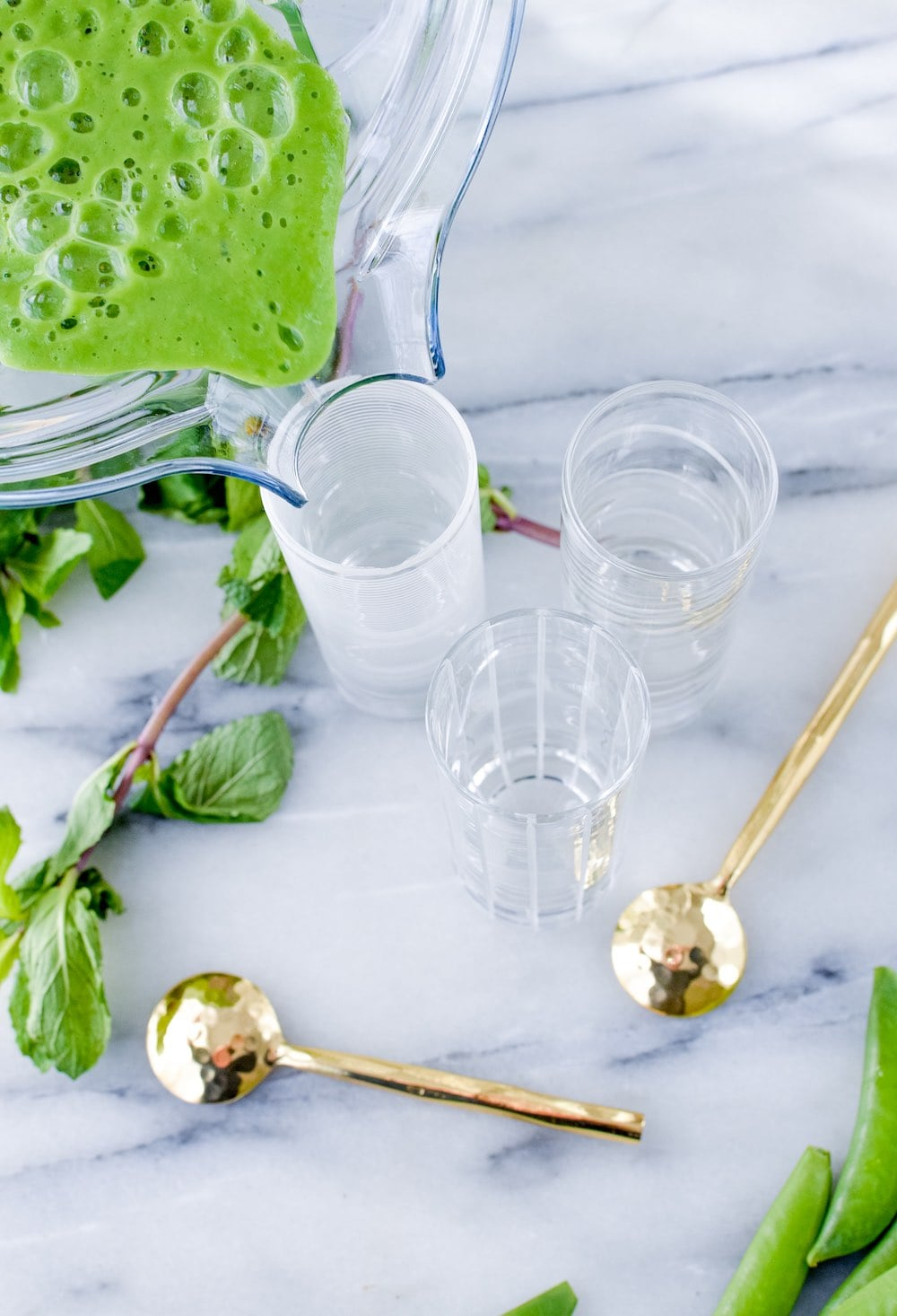 Pour the cold pea soup into bowls, shot or shooter glasses.