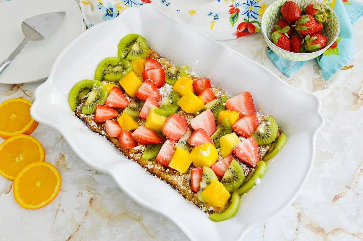 Mango french toast in a white casserole dish.