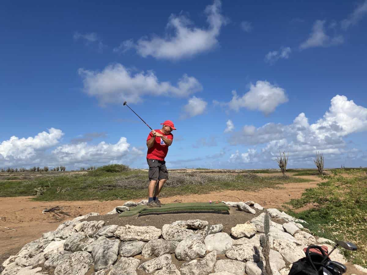 Man golfing at Piedra So Golf Course. Credit Eric Gietman