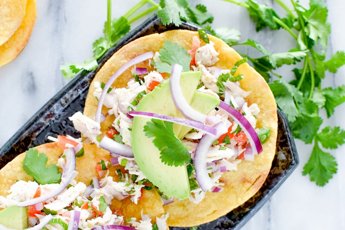 Close up of Mexican chicken salad on tostadas.