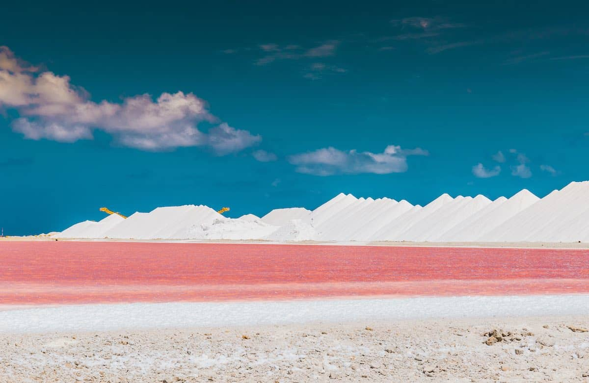 Pink salt pans of Bonaire with mountains of salt.