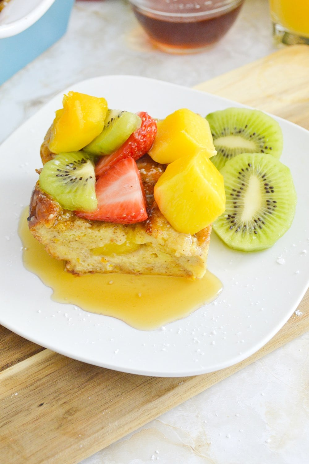 Mango stuffed French Toast with maple syrup.