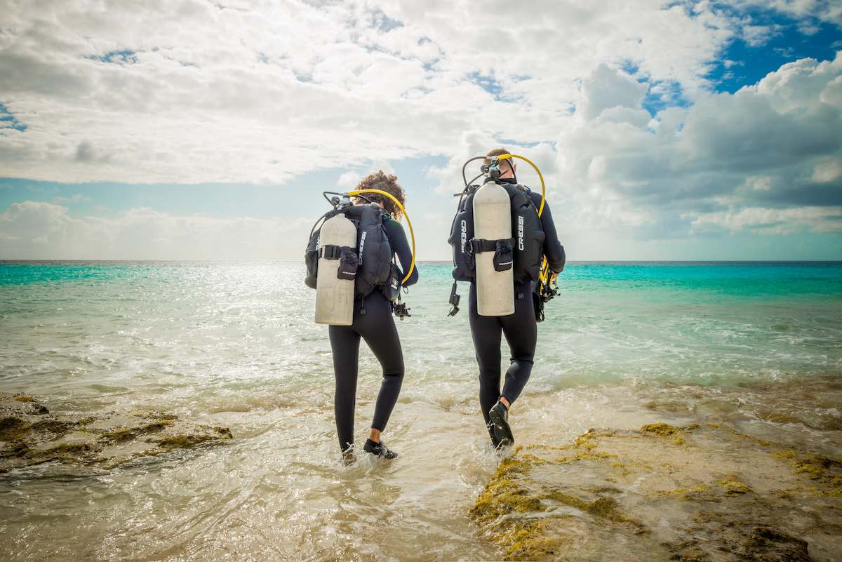 Two people shore diving in Bonaire.