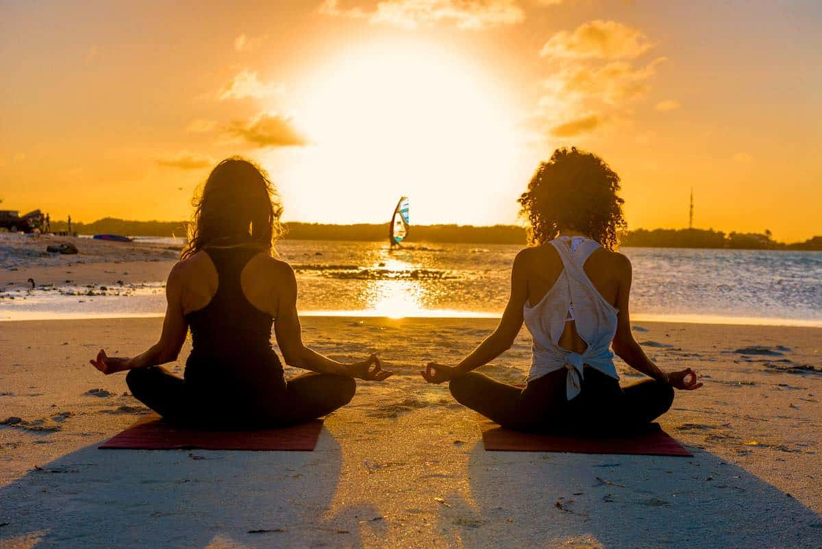 Two women doing yoga on Bonaire.