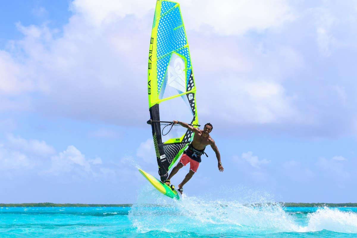 Young man windsurfing in Lac Bay on Bonaire.
