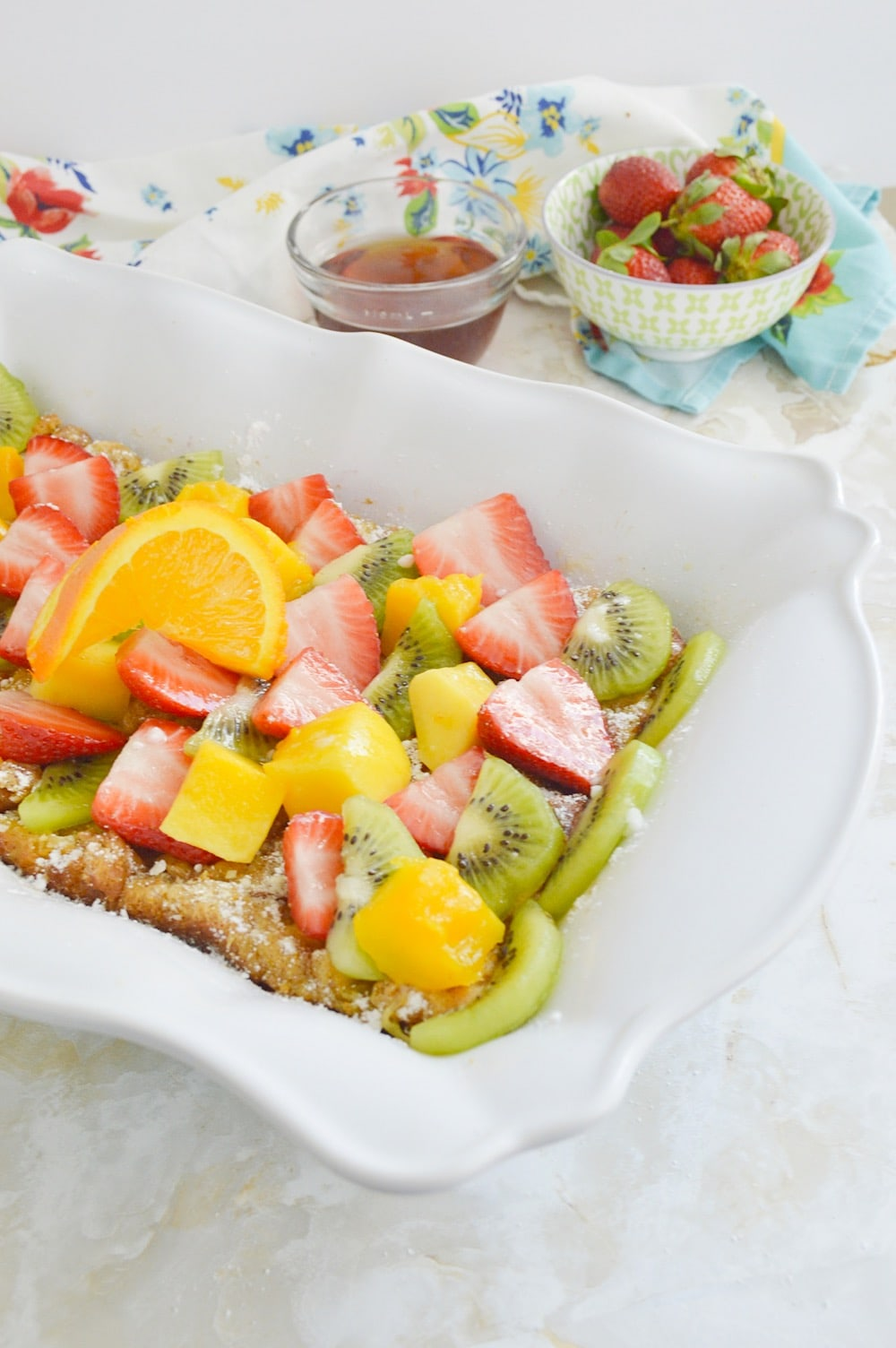 Make-ahead French Toast bake in a white casserole dish.