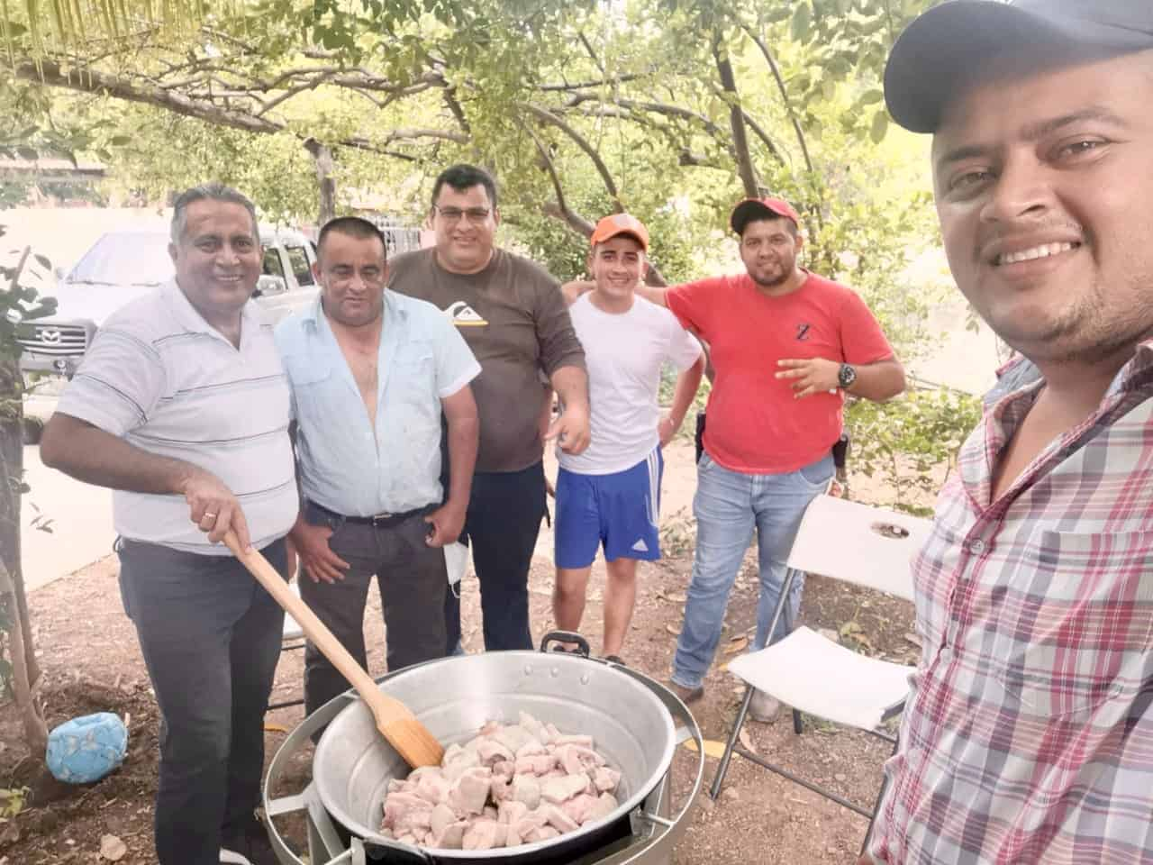 Making chicharrones outdoors in Guatemala.