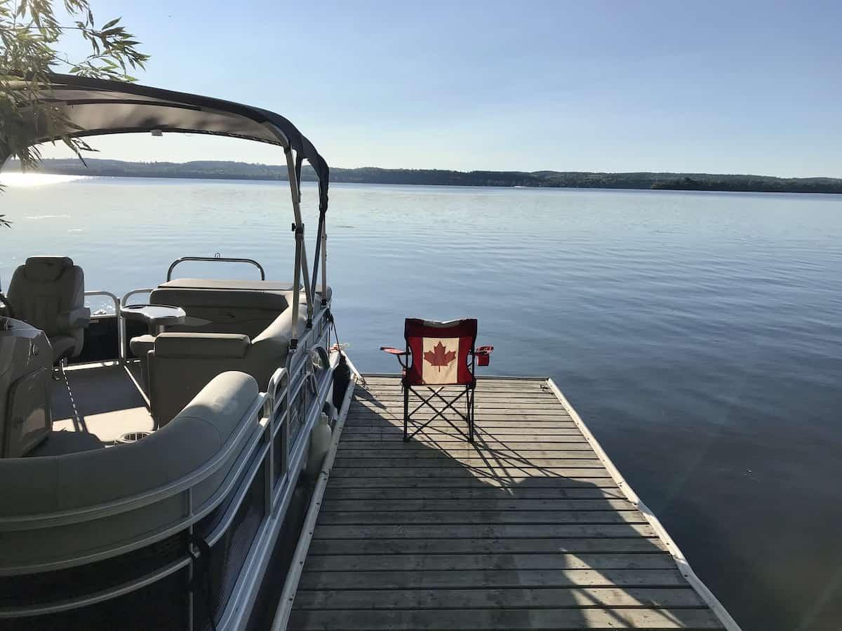 Bennington pontoon boat docked at Rice Lake.