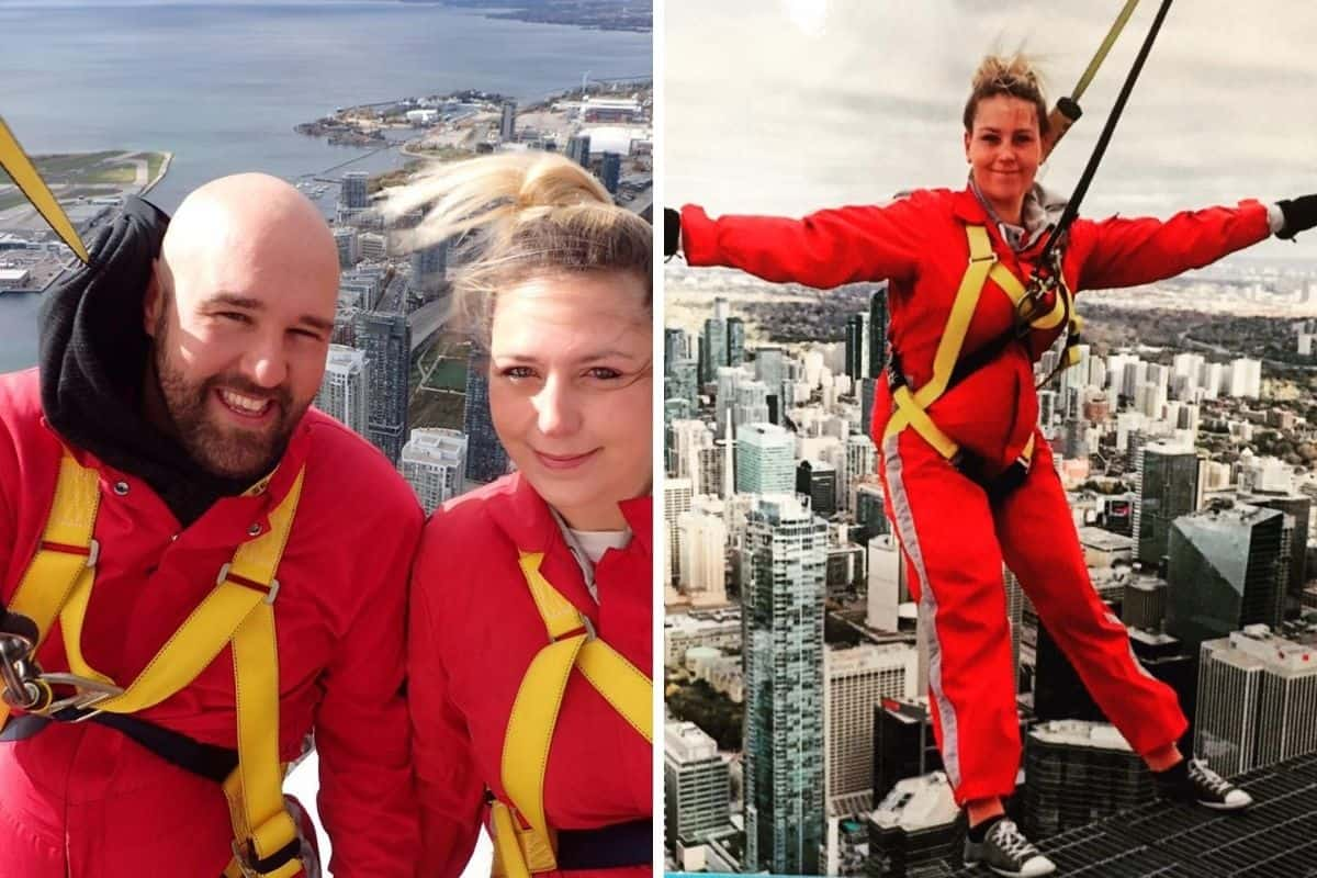 Young couple on the EdgeWalk at CN Tower.
