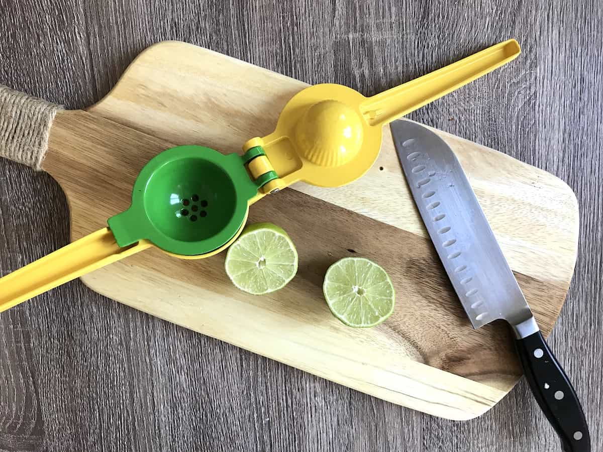 Cutting limes on a wooden board