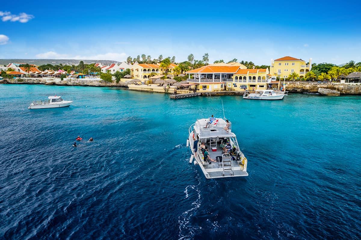 Boat approaching Buddy Dive resort in Bonaire.