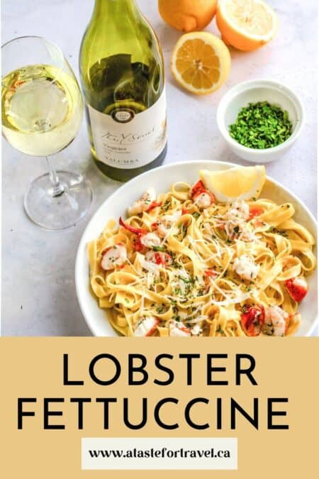 Bowl of pasta with a bottle of white wine.