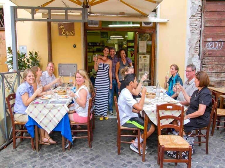 Group of people dining at Da Enzo Restaurant in Rome.