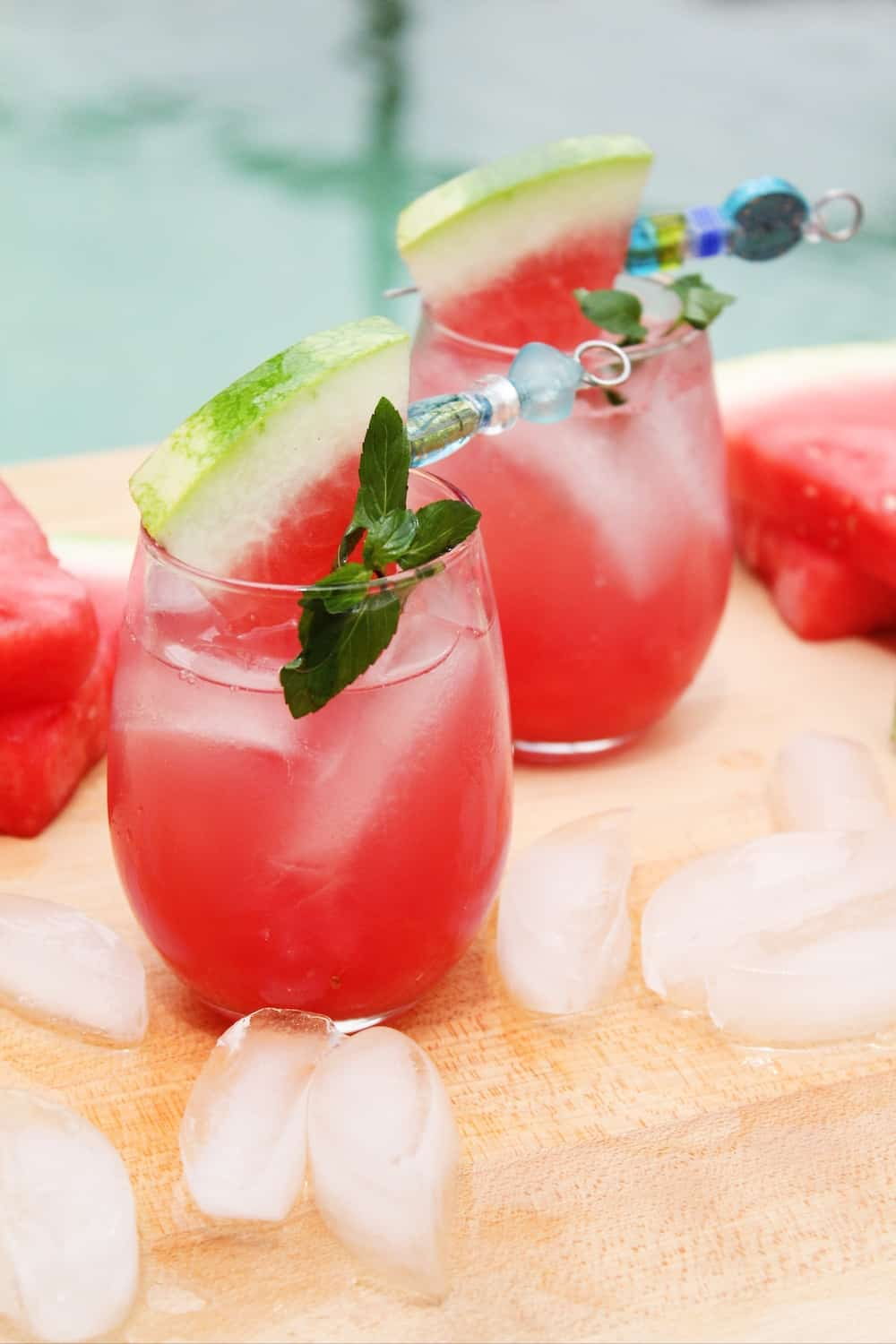 two glasses of a vodka and watermelon cocktail with ice.
