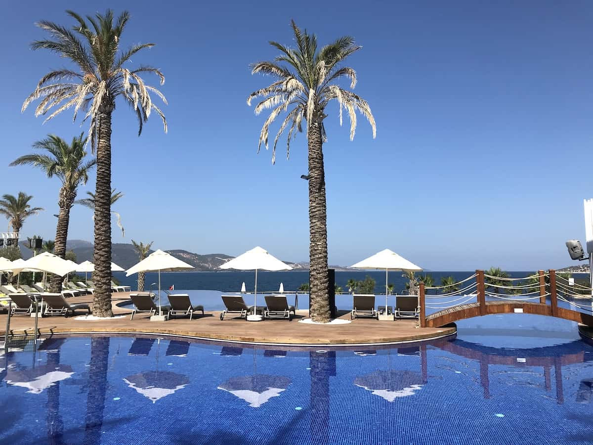 Palm trees and swimming pool at Be Premium luxury resort in Bodrum.