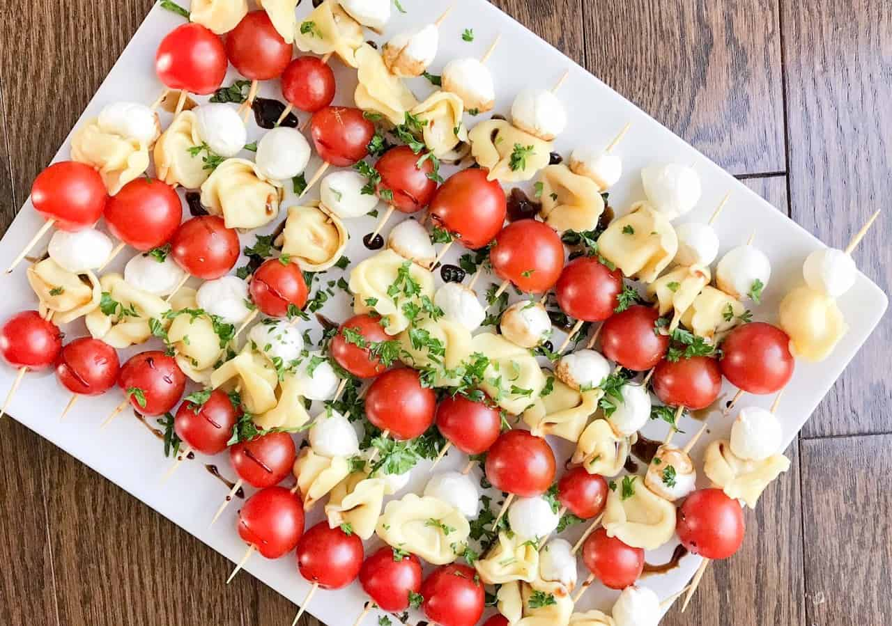 A tray of tortellini skewer appetizers to take on a boat.