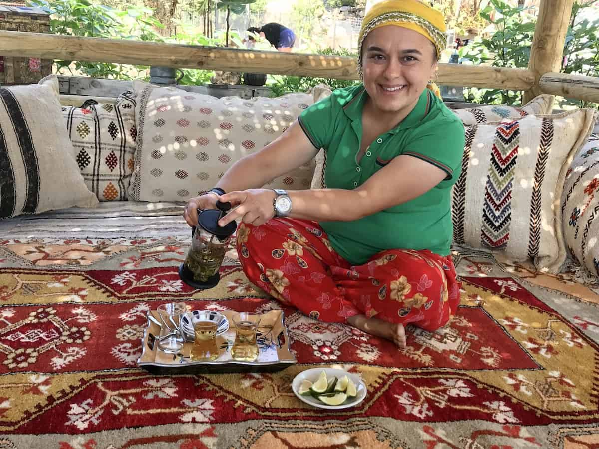 Woman pouring tea at family-owned Bekiroğlu Olive Oil Factory.