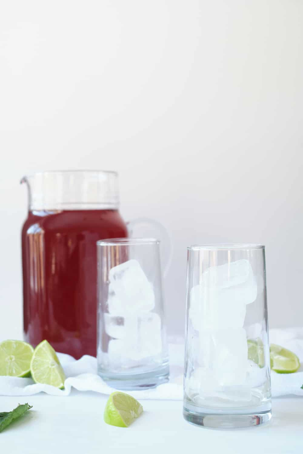 Cold brew hibiscus tea in a glass pitcher.