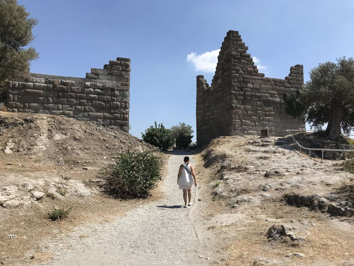 A woman walking through Myndos Gate once part of the fortified walls of Bodrum.