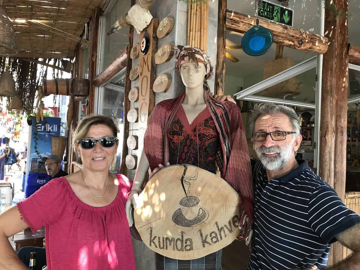 A Turkish man and woman standing in front of a cafe in Turgutreis, Turkey.