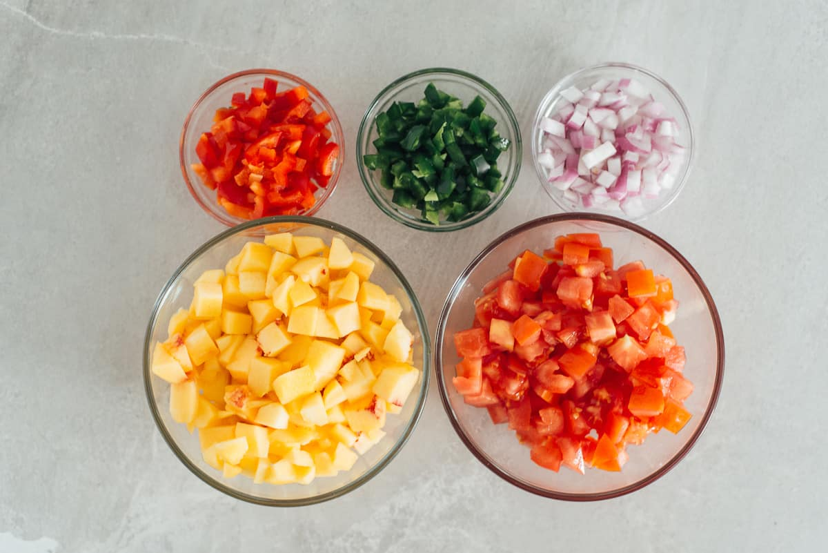 chopped fruit and vegetables in bowls.