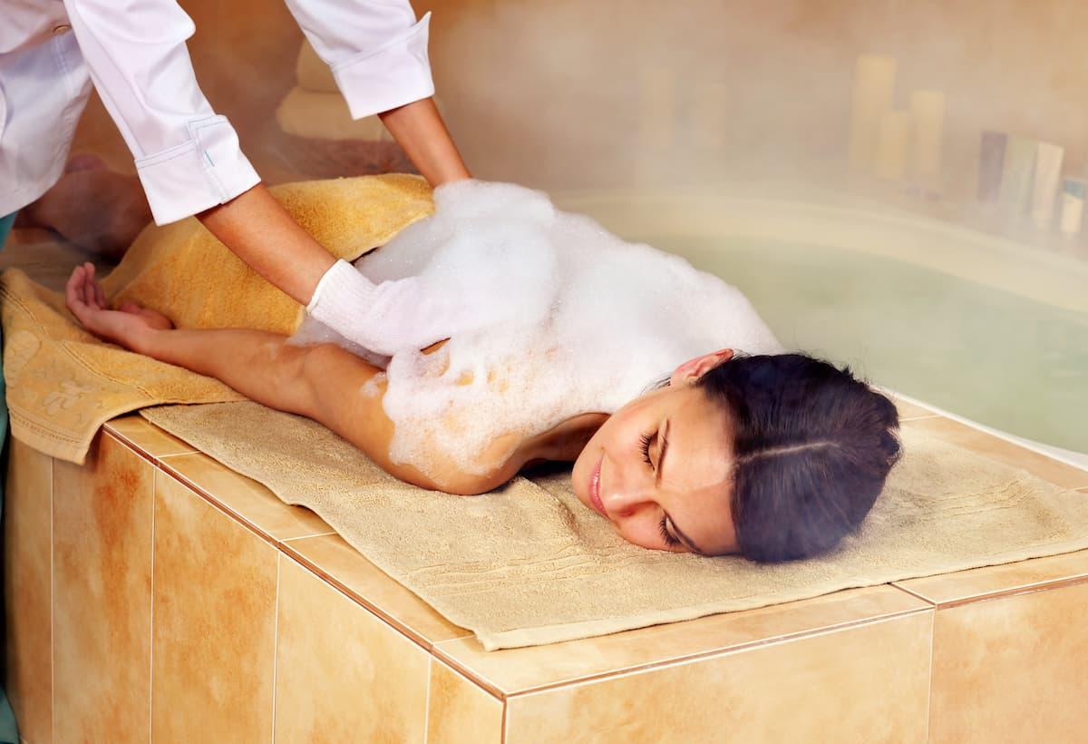Woman in hammam or turkish bath.