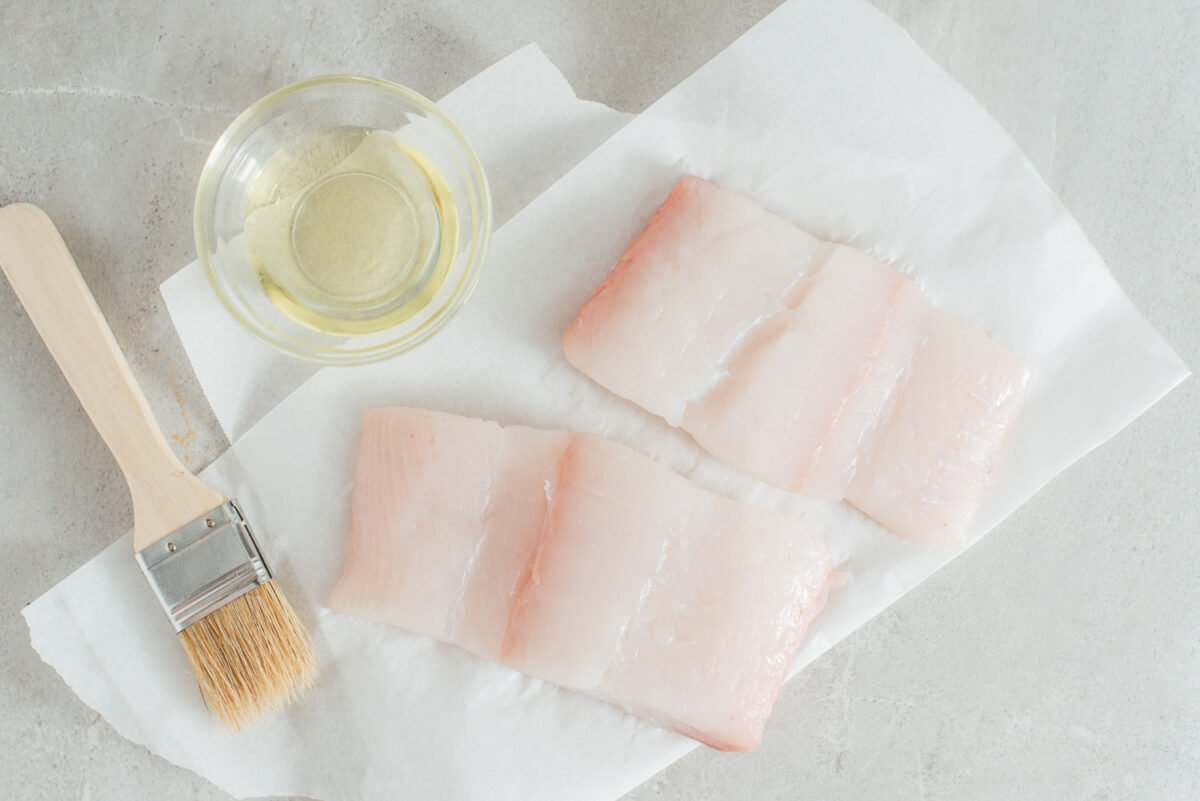 Two pieces of raw halibut.