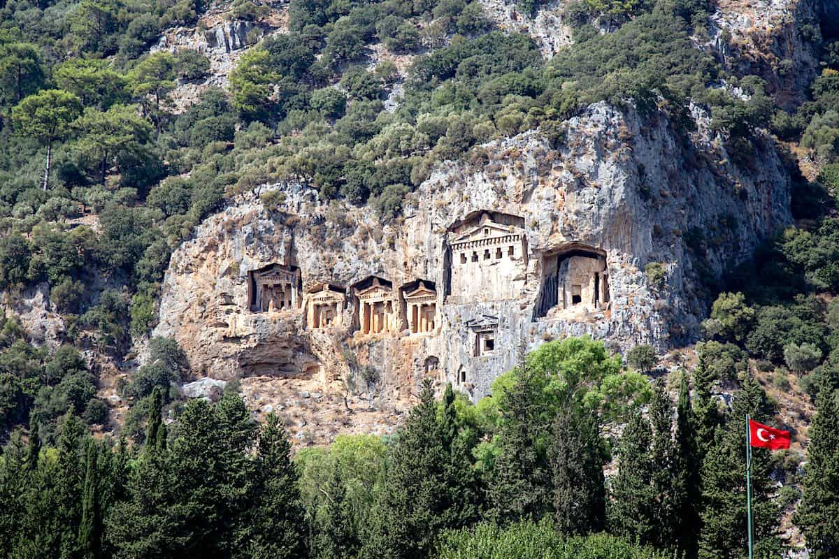 Facades of rock tombs cut from the sheer cliffs in ancient Kaunos.