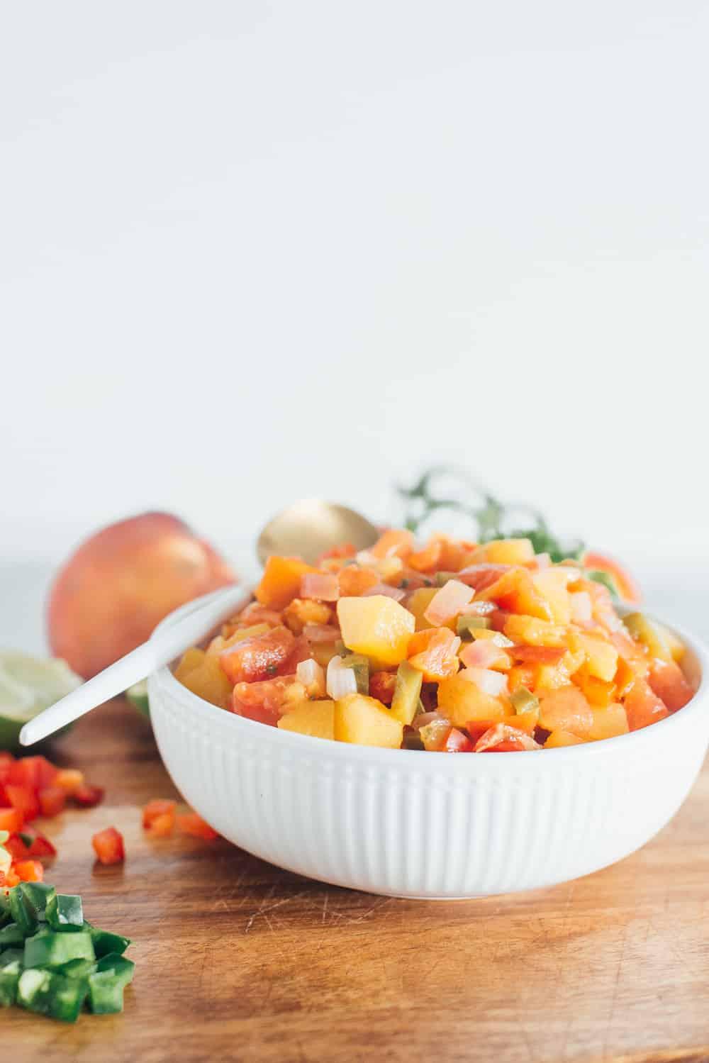 Peach salsa in a white bowl.