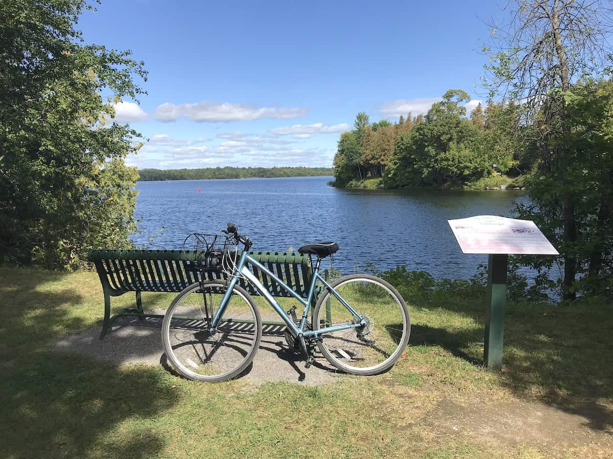 View of a bicycle in front of a bench overlooking Lake Katchewanooka in Lakefield.